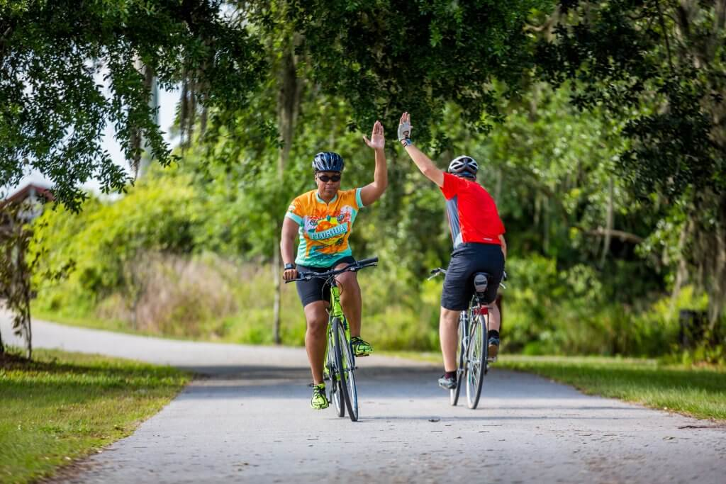 Central Florida tourism photo of cycling. Road bike, hybrid bike on paved trail.